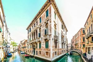 Typical romantic scene with traditional venetian building between the channels  in Venice, Italy