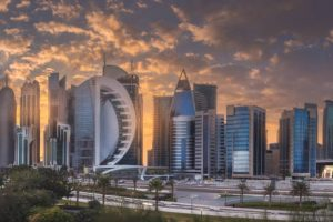 View of park and building in Doha City Center during sunset, Qatar