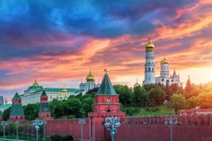 The fiery glow of the sunset over the towers and temples of the Moscow Kremlin